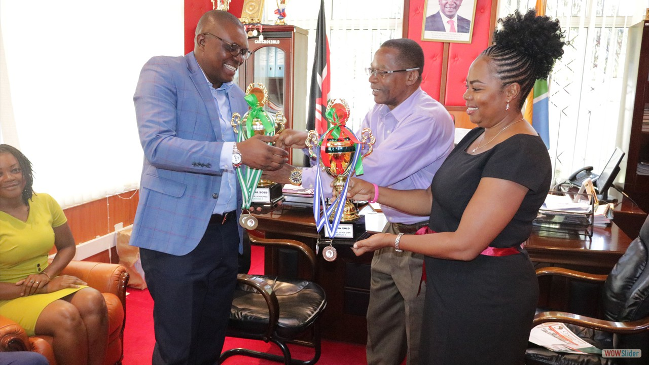 The Hon. Clerk, CPA Michael B Ngala receiving trophies won during 2019 CASA games in Eldoret, Uasin Gishu County.